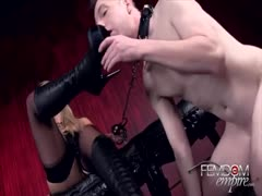 Blonde has boots licked and rubs pussy
