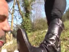 Leather boots cleaning outdoors
