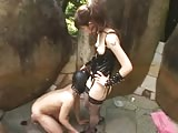 Young Asian femdom  goddess violating  slave ass outdoors