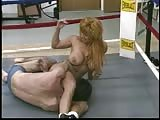 Mixed wrestling in the gym by a busty woman