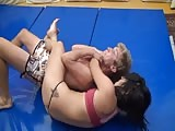 Beating her man down in their wrestling match
